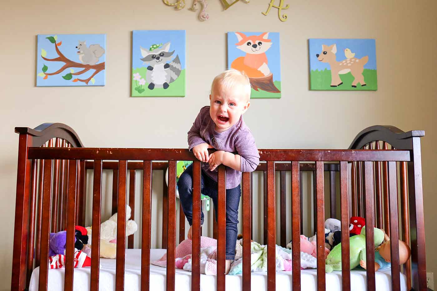 1 year old climbing out of the crib crying