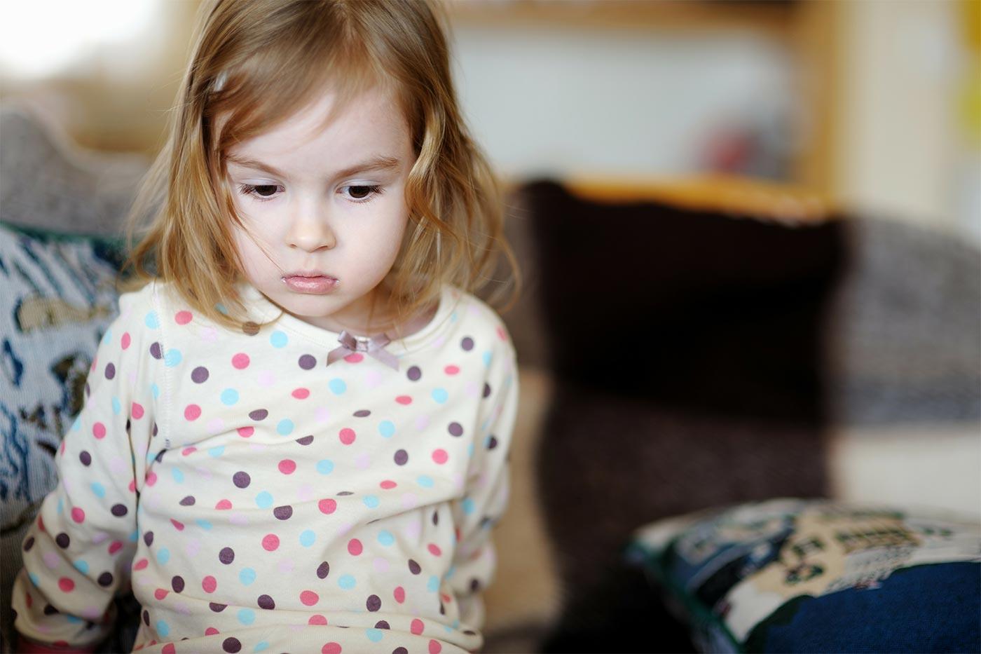 Little girl in her pajamas, scared in the dark