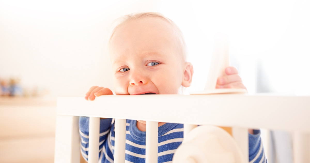 Toddler crying in his crib