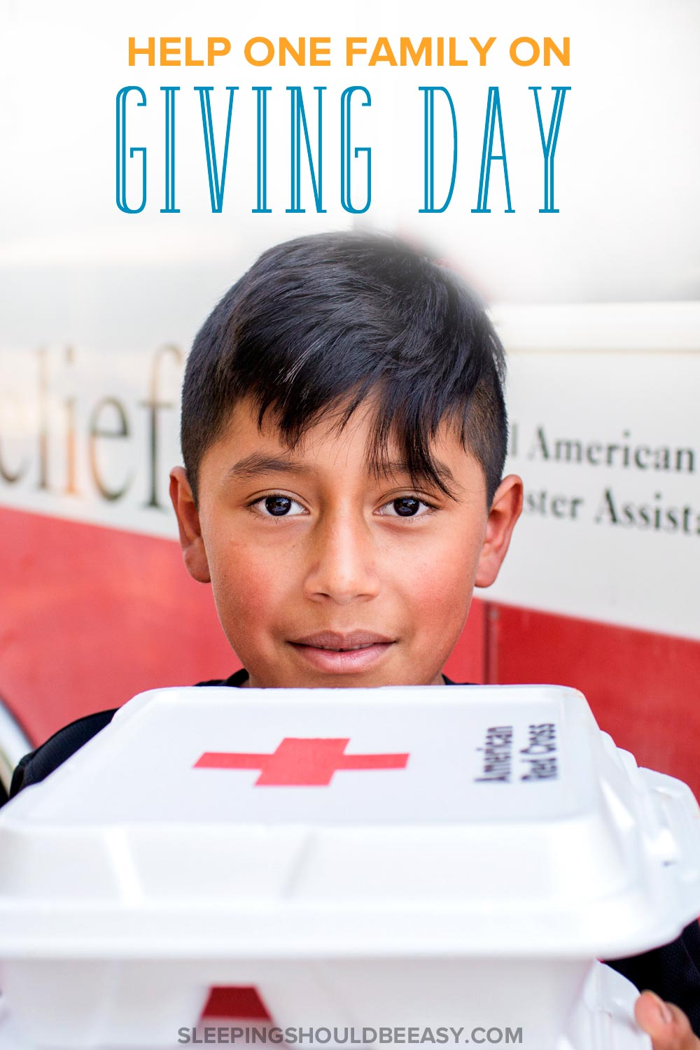 Boy receiving supplies during Red Cross Giving Day