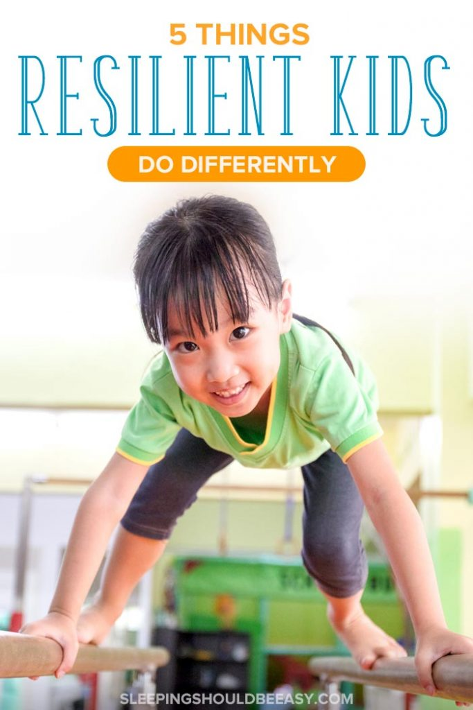 Little girl on gymnastics equipment, demonstrating characteristics of a resilient child