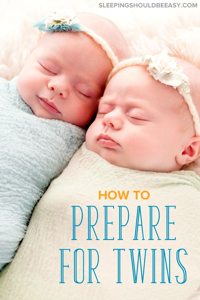 Preparing for twins: two swaddled babies asleep