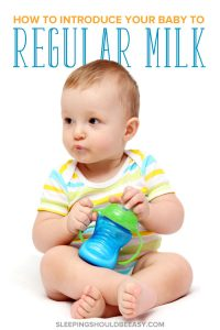 How to introduce cow's milk to baby: Baby holding a sippy cup of milk