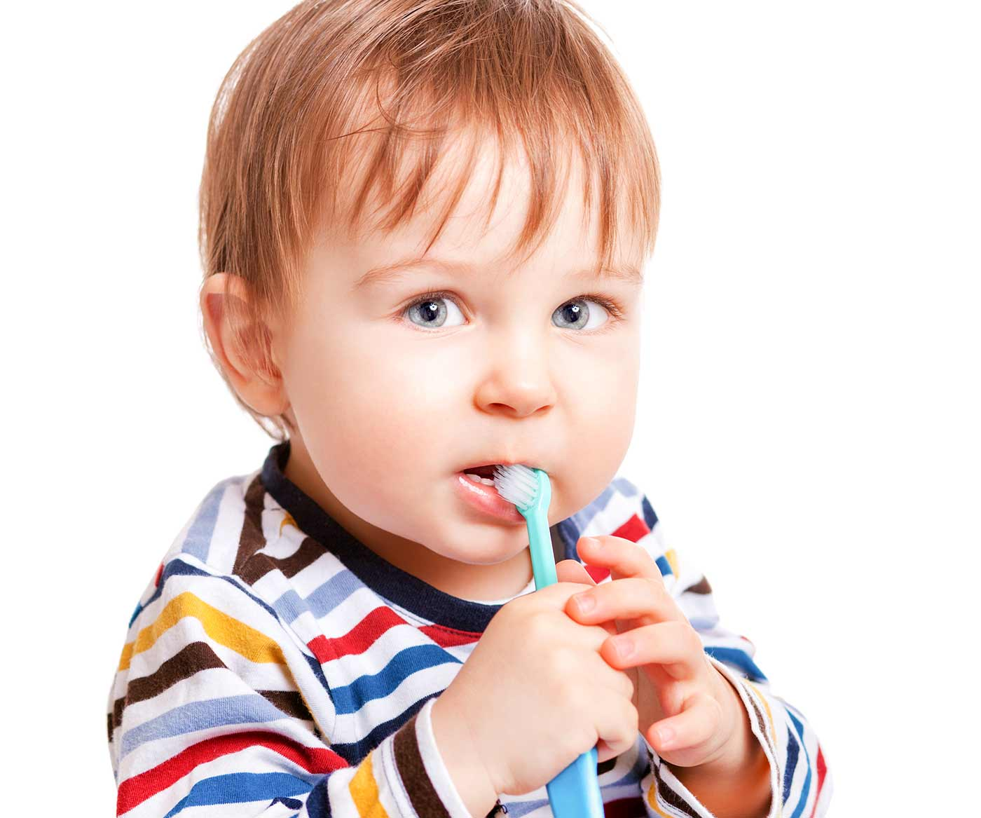 A little toddler brushing his teeth