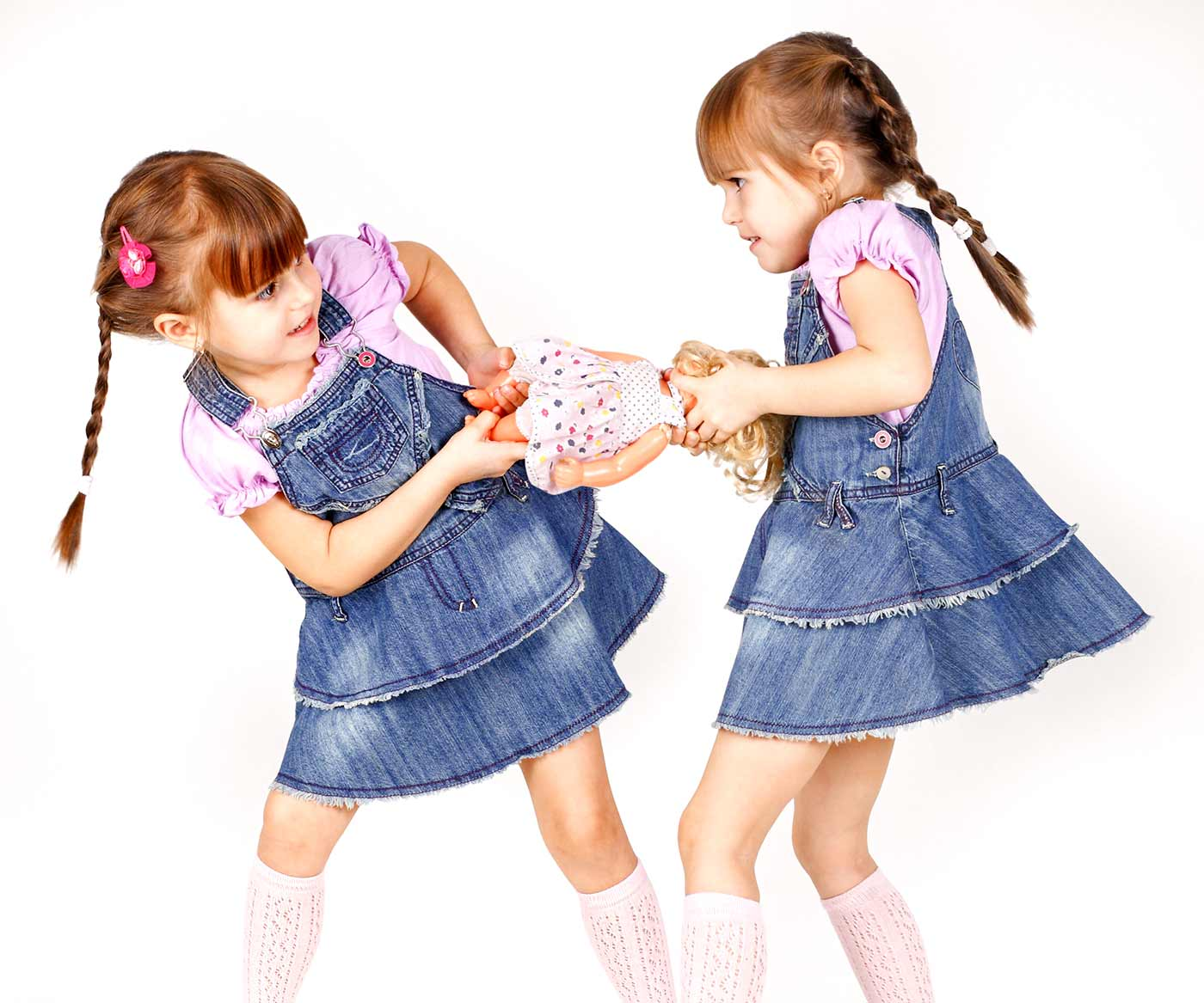 2 girls fighting over a doll