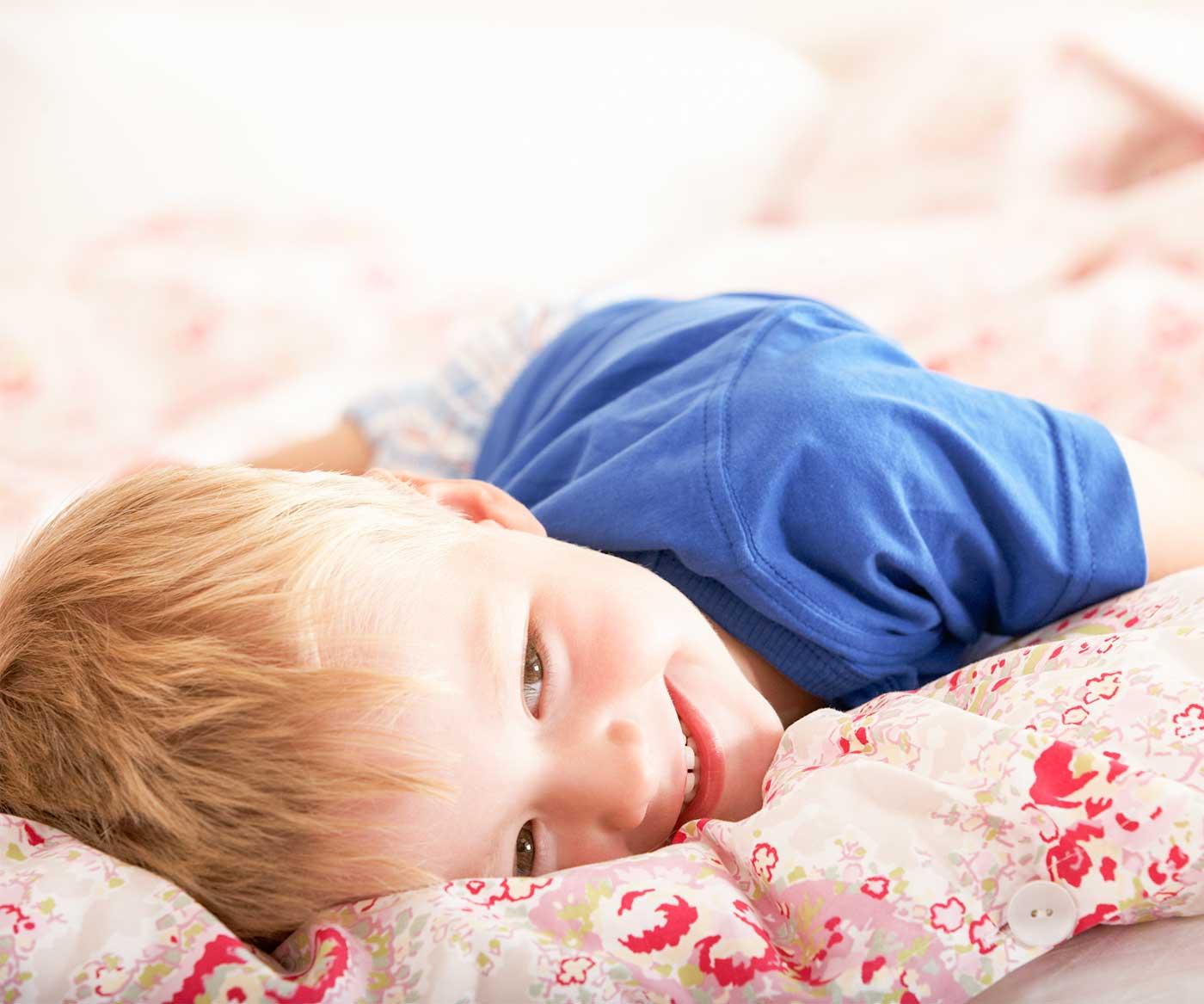 Little boy lying down on a blanket
