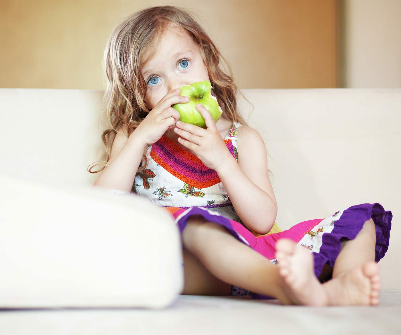 Little girl eating an apple