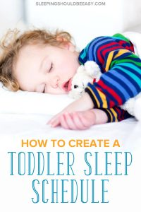 A little boy sleeping thanks to a good toddler sleep schedule