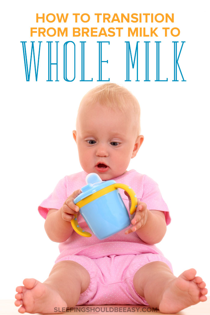 A little baby holding a sippy cup, transitioning from breastmilk to whole milk