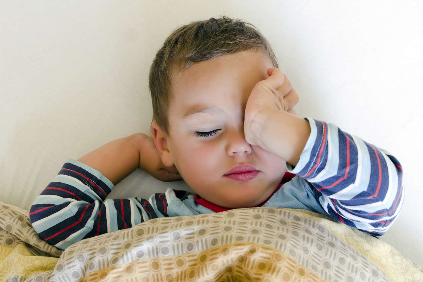 Tired little boy going through a 2 year old sleep regression