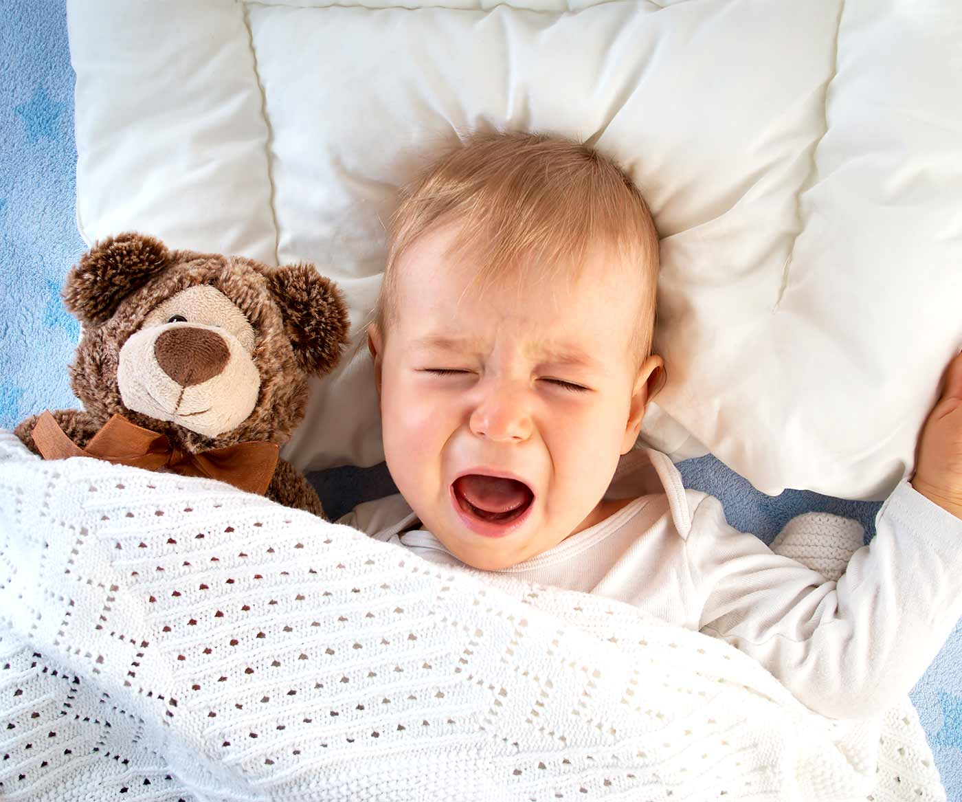 A little boy going through toddler sleep regression