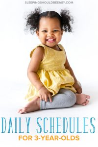 Little girl sitting and smiling, enjoying a 3 year old daily schedule