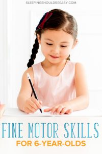 A little girl writing and practicing fine motor skills for 6 year olds