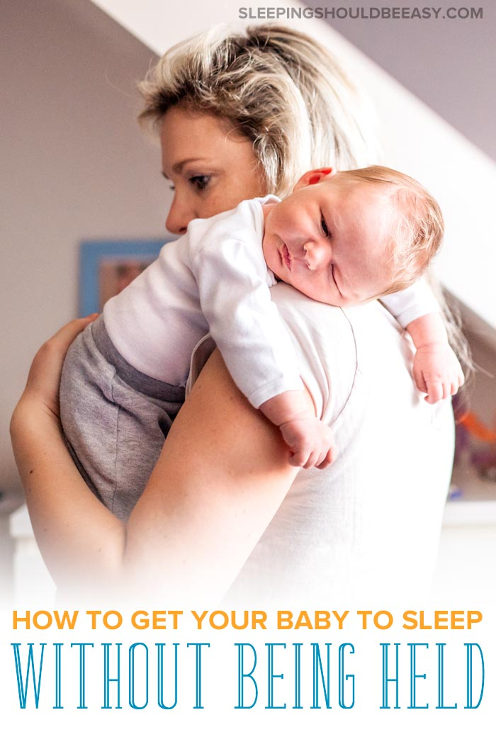 Mom carrying her newborn, wondering how to get your baby to sleep without being held