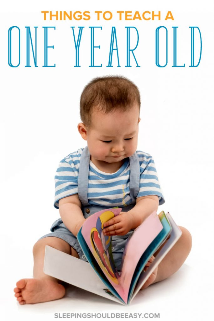 Things to teach a 1 year old, little boy reading a book