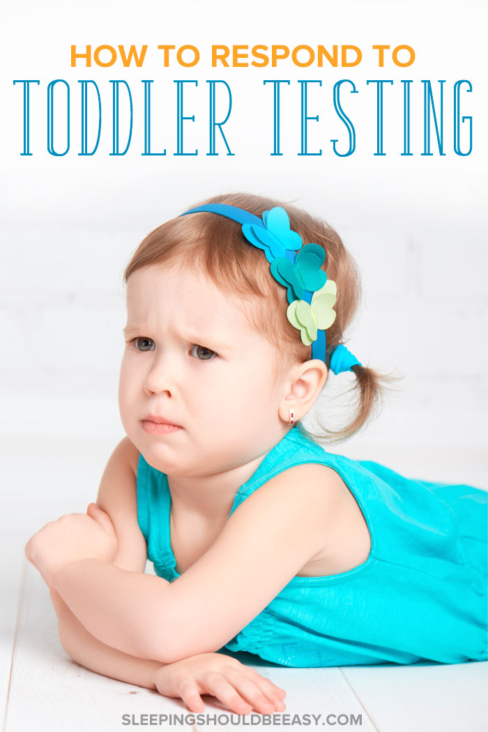 A toddler testing herl imits, lying on the ground upset
