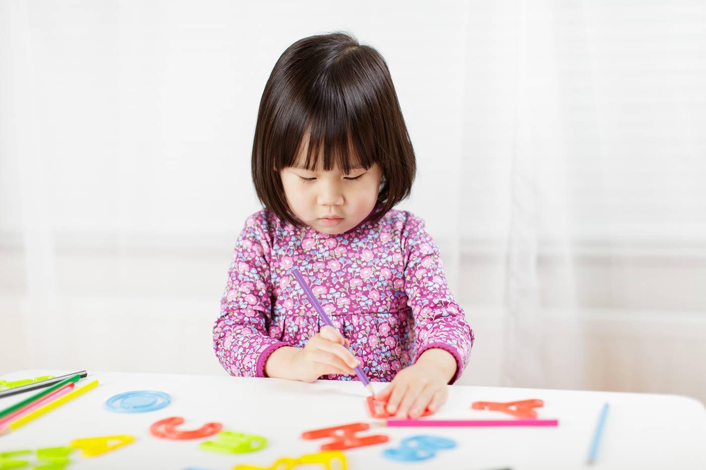 Toddler practicing writing