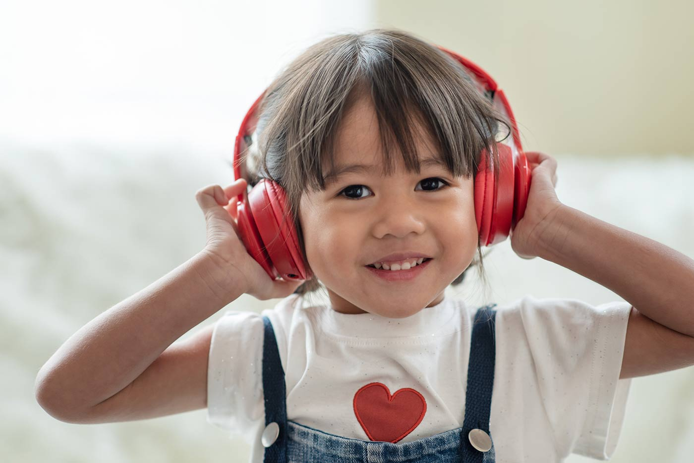 Happy child listening to music on headphones