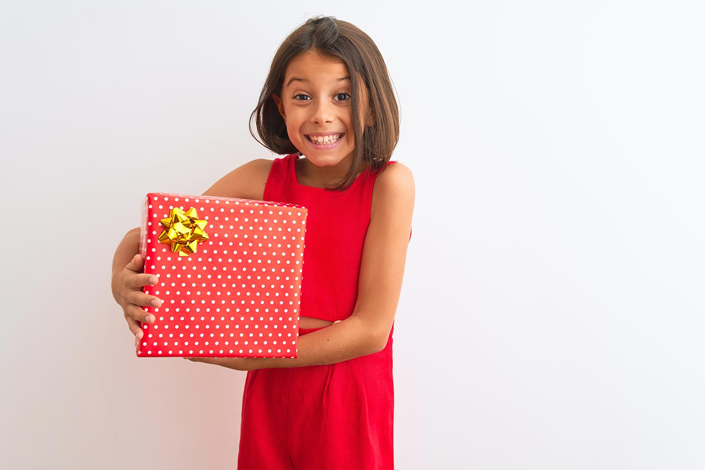 Child holding a birthday gift
