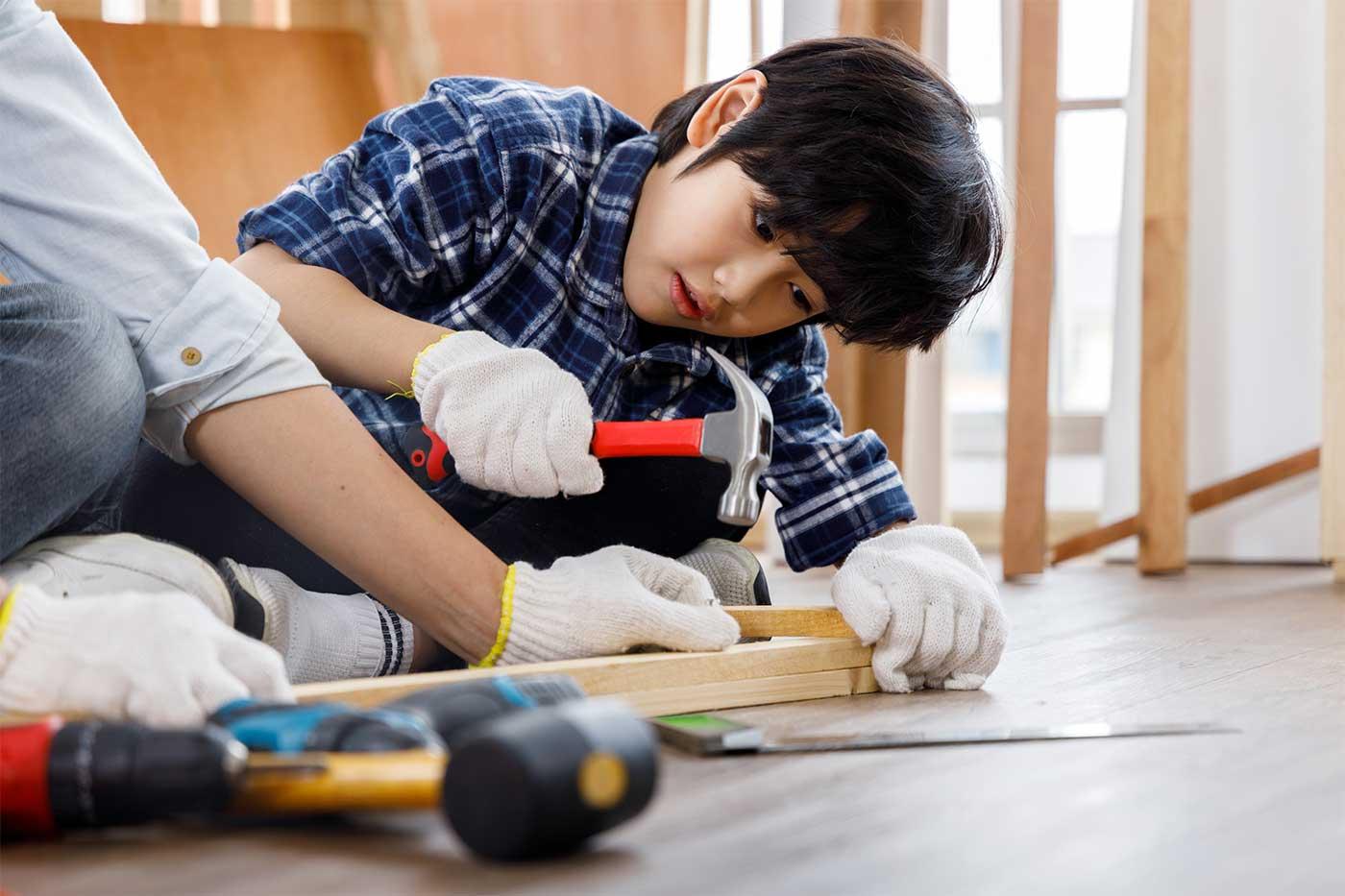 boy nailing wood