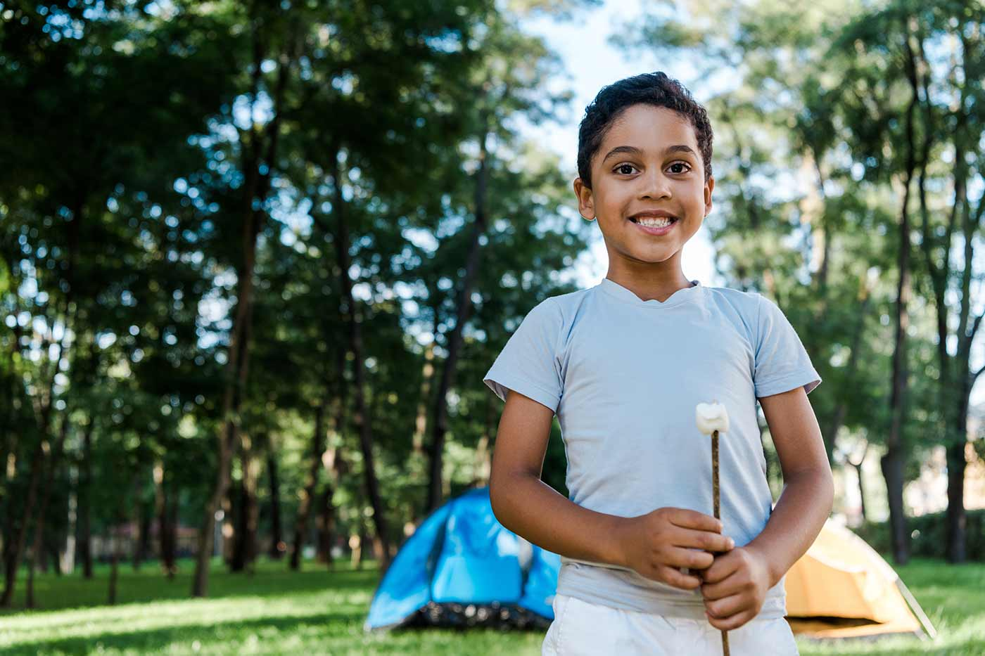 boy holding a marshmallow for summer camp