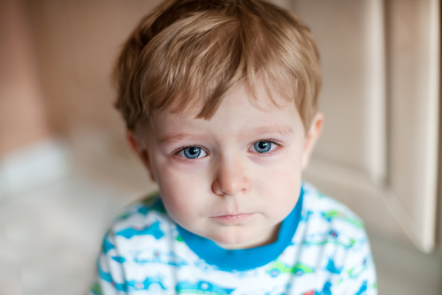 Crying toddler boy with blue eyes and blond hairs