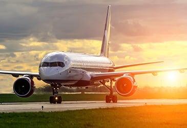 Airplane landing at sunrise