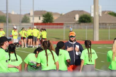 Head coach Devin Amodio speaks with his offense. Although they entered half-time with a lead, Devin was set to keep it.