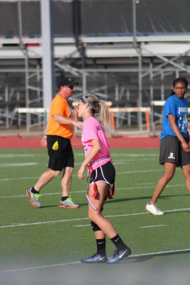 Brianna Mickshaw lines up before a play. As a wide reciever, it is her job to run routes and catch the ball.