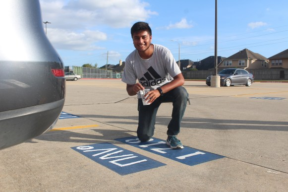 With the help of his friends, senior Arnav Karandikar puts the final touches on his senior spot. He drew inspiration from Canadian hip-hop artist, Nav, and his extracurricular sport, Varsity tennis.