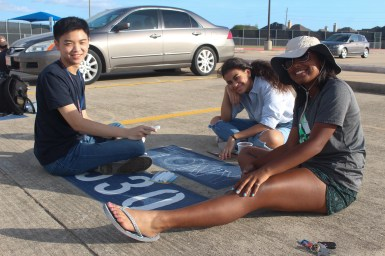 The severe Houston heat didn't stop seniors Tony Pham, Maria Prado, and Kavita Kulanthaivel from painting parking spots on the afternoon of August 15th. Pham made a simple design with his name and outlined his design out in chalk before he got started.