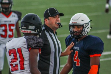 Junior Jalen Mosely argues with a Fort Bend Austin player. Tensions run high in football and sometimes it gets the best of players.