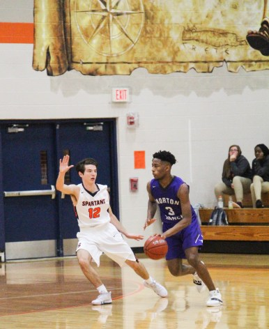 Senior Ethan Rothschild works hard on defense. It is important to have effective defense during the game.