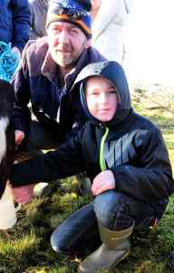 Leo gives Pierce a lesson on milking at the Imbolc Festival, Feb 1st 2015