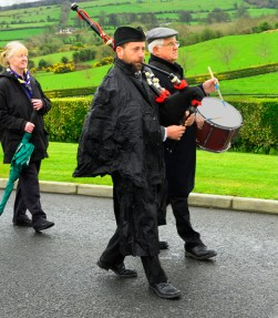 Leading the walk to the Paddy Lowry Plaque