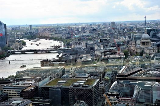 Looking west with St Pauls, and the Eye around the bend in the river