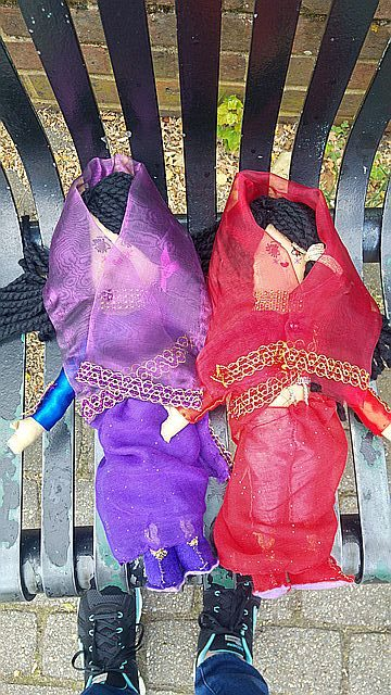 The finished dolls ready for delivery, and my feet!