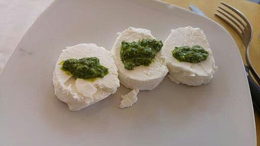 A traditional Piemontese appetiser - tomini (a soft cheese) al verde ( a sauce made with parsley and anchovy
