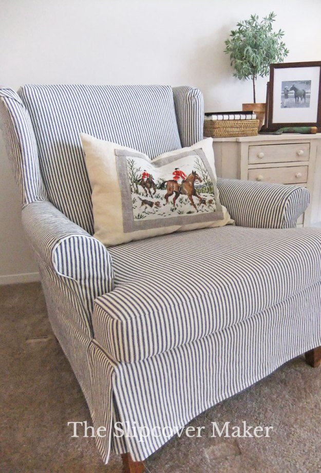 Custom-made ticking wingback slipcover.