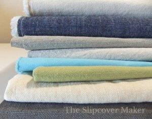 Stack of washable slipcover fabrics.