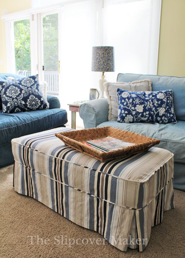 Striped canvas ottoman slipcover.