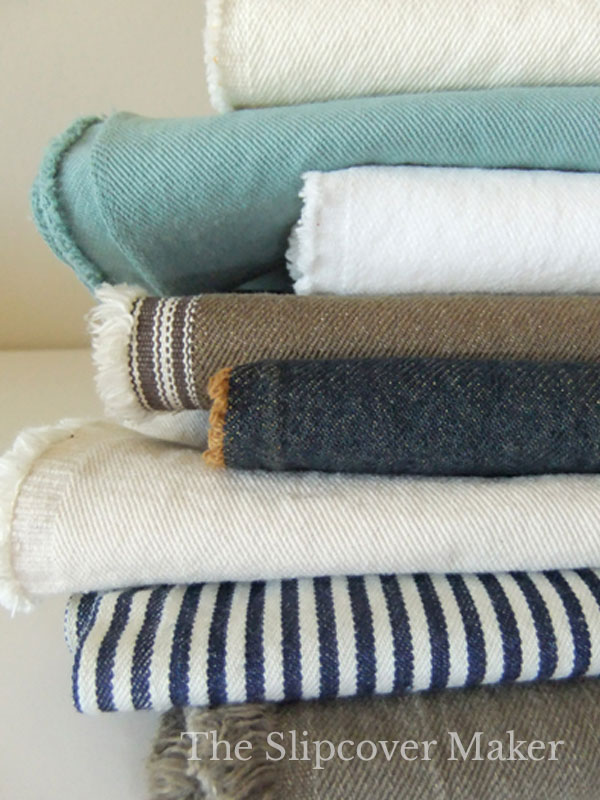 Stack of denim slipcover fabrics.