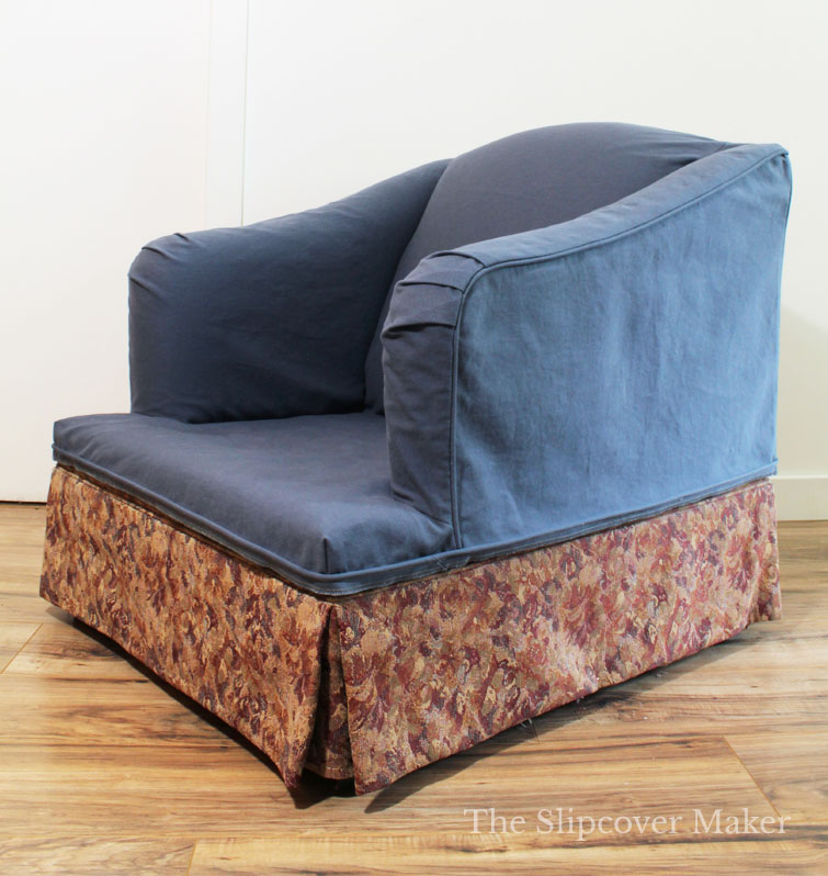 Blue slipcover on English rolled arm chair missing the skirt.