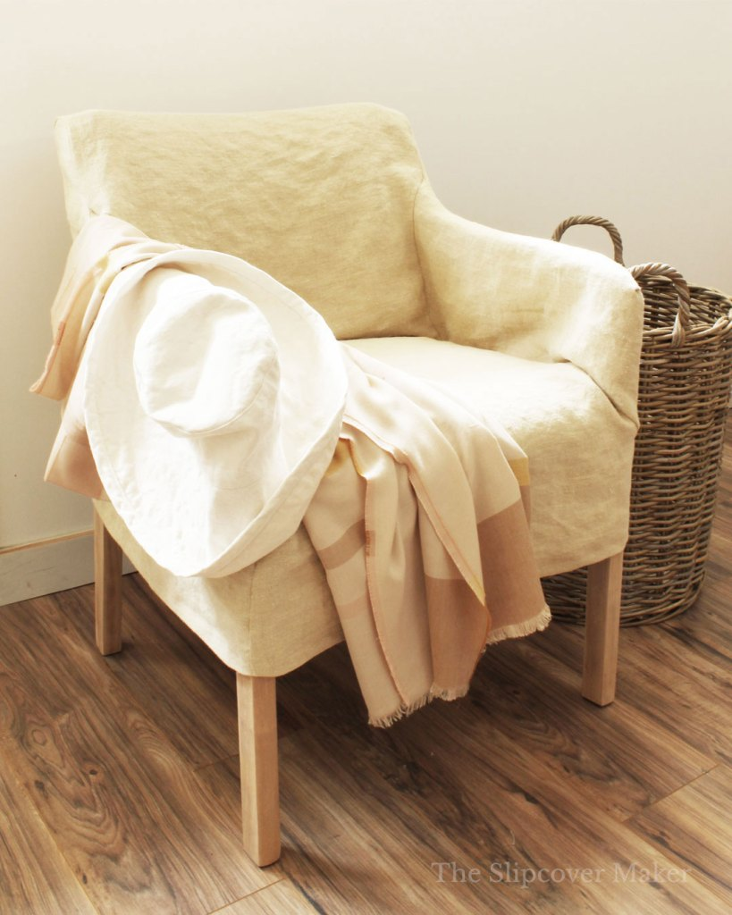 Natural color hemp slipcover for boxy chair.