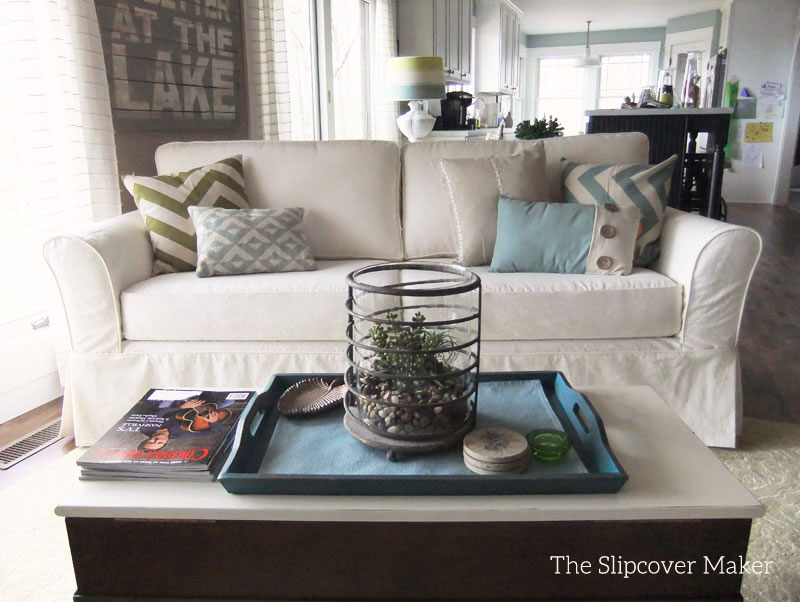 Boxy sofa with natural canvas slipcover.