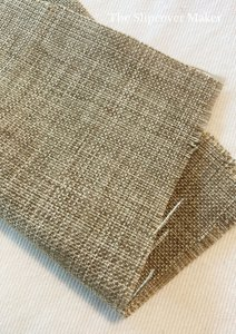 Textured brown polyester fabric swatch.
