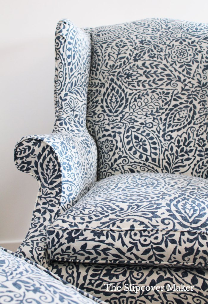 Wing back chair with box cushion in blue and white.