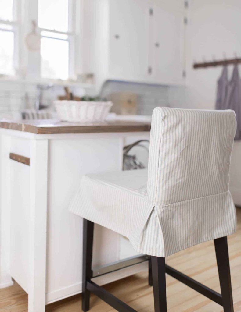 Striped slipcover on kitchen barstool chair.