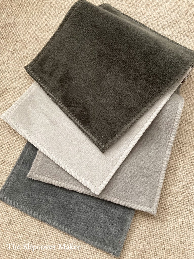 Swatches of polyester velvet fabric in neutral colors.