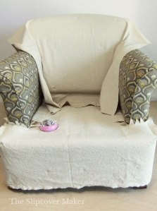 Cream canvas pinned to inner back chair.